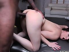 Wide spread brunette doing big black cock