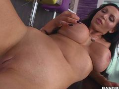 Dark haired busty MILF Nikki Benz is completely naked in