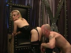 Beautiful blonde dominatrix Ash Hollywood dressed in black gets her