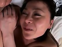 Naughty Asian milf with big boobs gets her slit eaten out a