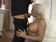 White haired MILF with big tatas shows off her assets