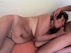 Kinky granny fucked by young stud