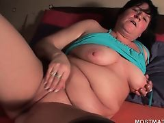 Brunette mature rubs cunt and teased boobs