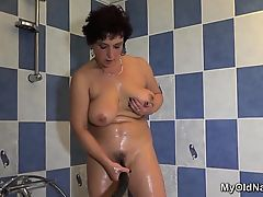 Big titted granny plays with herself