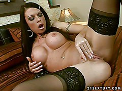 Gorgeous brunette Sonya with huge fake tits spreads her stocking-clad
