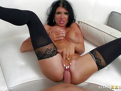 Romi Rain is a super horny dark haired pornstar with