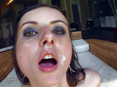 Slender petite black haired bitch with cheep make up and