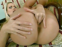 Young adorable blonde babe Celine with arousing heavy make up
