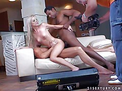 Slender young blonde with dark heavy make up and soft