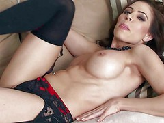 Erika Jordan is a big boobed seductress in black nylons.