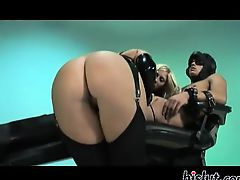 Latex clad whores enjoy a rod and a dildo