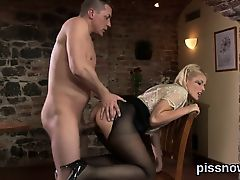 Surprised hottie in lingerie is geeting urinated on and nail