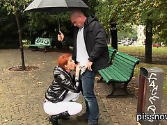 Surprised sex kitten in lingerie is geeting urinated on and